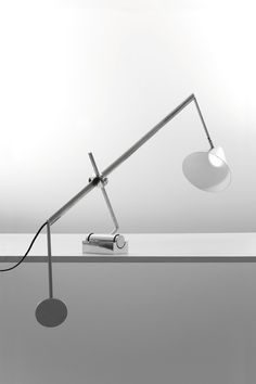 Lighting Design // minimalist table lamp. The counterweight system allows the lamp to be balanced with different angles // LIBRA LUX | NEMO