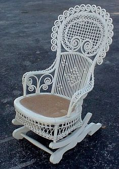 ~ Gorgeous Antique Rocking Chair ~ http://www.burchardgalleries.com/auctions/2001/nov1801/l010a.jpg