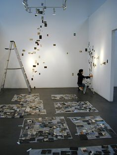 Installation of Yamamoto Masao's Nakazora-what was even more memorable was the way he silently placed eleven of his small photos on a glass table and started to arrange and re-arrange them into a kind of visual haiku. Each slight shuffle changed the poetry and context, and the possibilities seemed almost limitless.