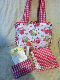 "Quilted Baby Doll Diaper Bag by Needies on Etsy, $26.95.   The bag is 12"" across, 9"" deep and 3 "" wide. It has two pockets on the outside. Inside has many pockets. Changing pad included, 16""x11 1/2""    Also included in the bag are…..  3 Preemie Pampers  Plastic doll bottle  Wipie holder"