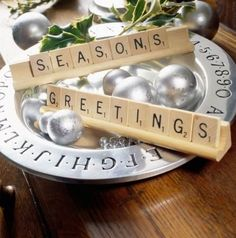 Using Scrabble game tiles, spell out a seasonal message. More Christmas centerpieces: http://www.midwestliving.com/homes/seasonal-decorating/easy-christmas-centerpiece-ideas/?page=21,0