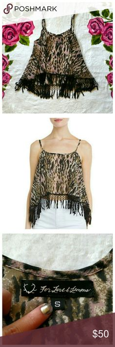 FL&L Shake It Top The Shake It top from For Love & Lemons is guaranteed to make you one hot mama! This sheer top is in a dusty leopard print and features a lacey black fringe along the hem. A bit shorter in the front than the back, straps are adjustable. From an older 2013 collection and sold out everywhere. For Love And Lemons Tops Tank Tops