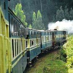 This is a photo taken by me from the Nilgiris Mountain Train, Ooty, India. This 115 year old train built by the British still chugs along the hills. It was bestowed with the prestigious UNESCO World Heritage Status recently. It is a must try
