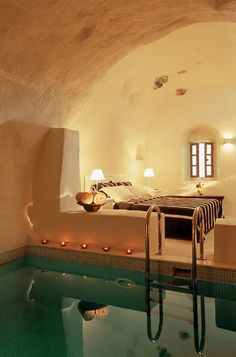 Pool in the bedroom. I love the walls/ceiling of this room and the color of the water against the earthy tones.