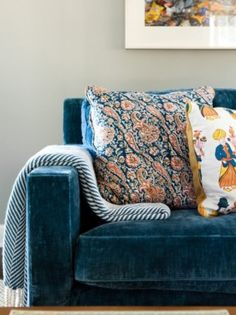 Gorgeous blue velvet couch with complimenting patterned pillows
