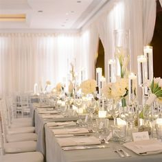 Shimmery pewter lines and clean, architectural centerpieces of white roses, calla lilies and hydrangeas made for an elegant look