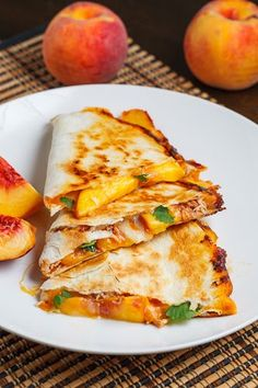 BBQ Chicken and Peach Quesadillas, maybe small appetizer food, i.e. sliders, southwest eggrolls, things that can be eaten with hands.