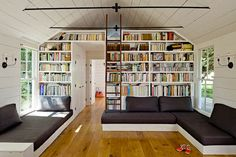 living room with tons of book shelves in tiny house photos by lincoln barbour   A Tiny House for a Humble Family