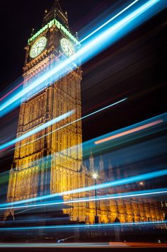 the picture was taken using a slow shutter speed. The website explained how to create light trails in a photo. Slow Shutter Speed Photography, Light Trail Photography, Panning Photography, Movement Photography, Light Painting Photography, Urban Photography, Night Photography, Photography Projects, Digital Photography