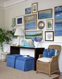 Love how the same shade of blue weaves through this gallery wall & the furniture.