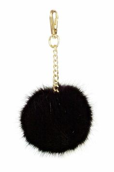 """Plush soft fur pompom in assorted fashion colors on gold metal link chains with attachment. Add a sophisticated flourish to your favorite handbag with this luxurious bag charm made from soft fur.    Measures 4"""" diameter.   Black Fur Pompom by Leather Country. Accessories - Keychains & Charms Portland, Oregon"""