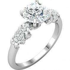 1.50 ct Diamond Ring with18 smaller Diamonds