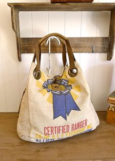 Blue Ribbon - Certified Ranger - Vintage Seed Sack Open Tote -Americana OOAK Canvas & Leather Tote. $135.00, via Etsy.