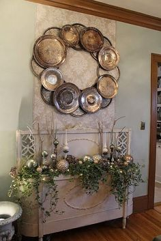 - i love everything in this picture. {decorative wood headboard and footboard turned into a planter & oversized silver wreath made from vintage silver trays and chargers}! I Susan particularly love the wreath shabby chic wreath