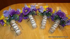 Burlap, lace and pearls bouquets. Each bouquet has pearls on the bottom for that added Chic. Bouquets have burlap flowers mixed in. This set is Sunflowers and lavender. www.silkweddingflowersforless.com
