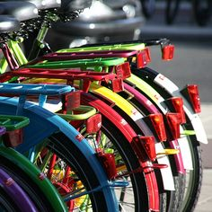 """i'll just park my motorized fietsen (Dutch for bikes #ridecolorfully ) here in Amsterdam among these brilliant colors and no one will even wonder, """"what doesn't match in this picture?"""""""