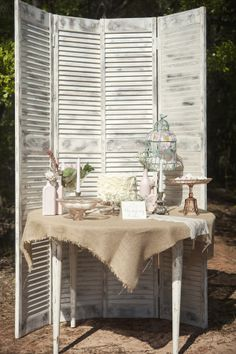 Shutters of old doors are a unique backdrop for smaller cocktail hour or dessert stations #LiquidGoldSalvagedWood