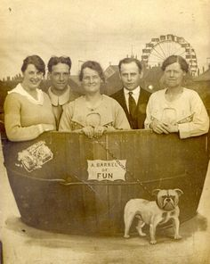"""Antique """"Barrel of Fun"""" pic from a fair. Posted on Retro Ramblings.... My eye goes right to the tiny sign """"a barrel of fun""""- as if an explanation is needed. - awesome. And the dog...adorable."""