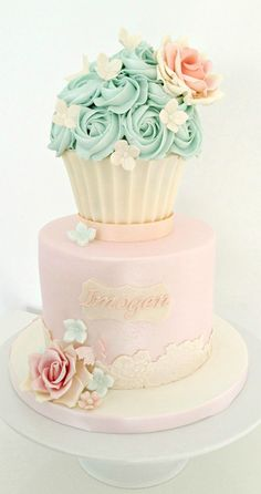 Vintage style cake and giant cupcake in pink and duck egg blue #wedding #birthday #cake http://www.flickr.com/photos/swirlsbakery/