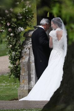 Pippa Middleton and her father Michael Middleton arrive for her wedding to James Matthews at St Mark's Church on May 20, 2017 in Englefield Green, England.