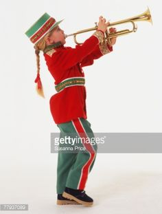 View top-quality stock photos of Side View Of A Young Girl Wearing A Marching Band Uniform Playing A Trumpet. Find premium, high-resolution stock photography at Getty Images. Marching Band Uniforms, Green Santa, New Year 2018, Girls Wear, Side View, Trumpet, How To Wear, Image, Women's Clothes