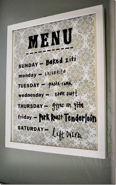 Frame pretty scrapbook paper or wallpaper, and use dry-erase markers on the glass to write your weekly menu! Photo: A Content Housewife