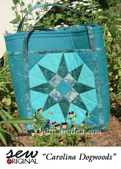 """""""Carolina Dogwoods"""" – this wonderful tote bag pattern uses a traditional star block and includes a zippered back pocket and original free-motion quilting design of the state flower, the dogwood! A 2017 Quilt! Carolina pattern."""