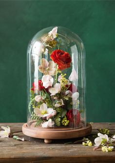 This red and pink cloche arrangement is so gorgeous!