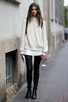 oversized sweater worn with black skinny jeans and ankle boots