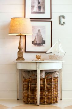 Here's a great example of decorating a beach cottage with antique pieces and old nautical photos.