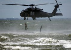 US Navy SEALS jump from a helo by AN HONORABLE GERMAN, via Flickr