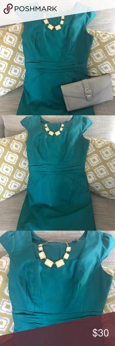 "Teal Dress Beautiful teal dress perfect for the stylish business woman or an evening out at dinner. Dress is approx 15"" waist, 17 chest, armpit to hem 26"". Zips up back and has rusching waistband for slimming effect. Good condition, no snags, tears or stains. Does need dry cleaning though. This dress is lined as well and from the higher end collection from F21. Forever 21 Dresses"