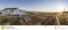 Traditional whitewashed house at Costa de la Luz seashore, Matalascañas, Huelva. Sunset