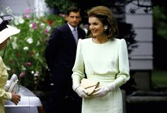 Jacqueline Onassis beaming at Caroline B. Kennedy's wedding in Centerville, Massachusetts. The mother of the bride wore a pale green streamlined sheath and tea-length gloves. July, 1986.