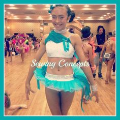 Love this really original white lycra crop top and pants with turquoise tutu style skirt with chiffon shoulder detail.