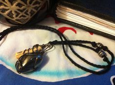 Hematite Resilience Charm Necklace by ArtCraftandNature on Etsy, $10.00