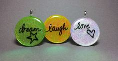 Custom holographic pendants.  Choose the color and wording.