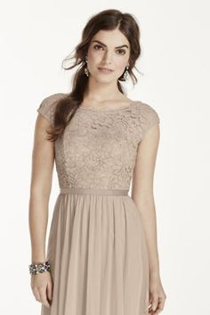 This beautiful lace dress is perfect for a wedding party or any special event!  COMING SOON!  Features cap sleeveillusion lace bodice, mesh skirt and grosgrain ribbon at waist.  Fully lined. Back zip. Lace 100% Nylon, Mesh 100% Polyester. Dry clean only.  To protect your dress, try our Non Woven Garment Bag.