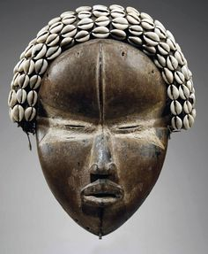 Africa | Deangle mask from the Dan people of the Ivory Coast or Liberia | Wood, fabric, shells
