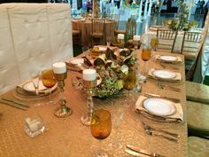 Columbus Bride: The Show Gold chiavari chairs, white Banquette chairs, gold taffeta sequins linen, light gold Versailles napkins, gold glass beaded chargers, glass with gold band plates, Alina plates, Ariana Amber wine glasses, Toscana champagne flutes, Savoy flatware. Florals provided by The Avant Garden.