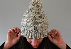 This fun Vermonter knitted hat has a playful pom pom on top and makes for a great gift. Its classic ski cap style gives this hat a vintage look and feel.