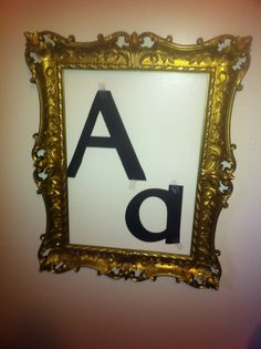 Highlighted letter of the day/week. I LOVE this idea! I might just have to go to a thrift shop tomorrow to find just the right frame...