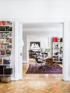 Nadia and Peter live in this 179 square meter apartment on the fourth floor of a beautiful building overlooking the rooftops of the city of Malmo, Sweden.