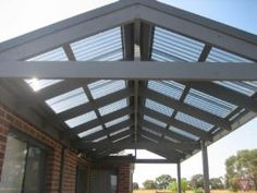 Polycarbonate roofing. This would be great for the apex of a barn to let light in while keeping UV rays out.