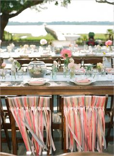 Pink and grey ribbon chair decor for bride and groom's seats. Captured By: Austin Gros http://www.weddingchicks.com/2014/05/28/get-married-in-charleston/