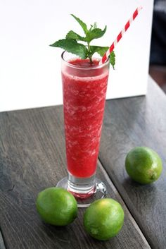 Frozen Strawberry Mojito -  Ingredients:  1 ½ - 2 cups crushed ice  1 cup frozen strawberries  3 - 4 oz rum  2 oz club soda  2 oz simple syrup  1 ½ oz lime juice  10 mint leaves, reserving the mint sprig and few leaves at the tip