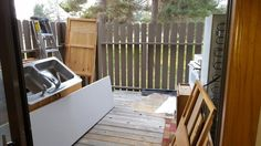 Deck with everything gutted including the kitchen sink,  literally!