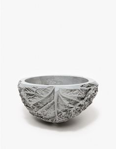 From the Brooklyn-based design team of Chen Chen and Kai Williams, a small cast cement planter molded from Savoy Cabbage. • Small Savoy Cabbage fruit-shaped planter • Round bottom • Hand cast cement • Drain hole • Made in USA