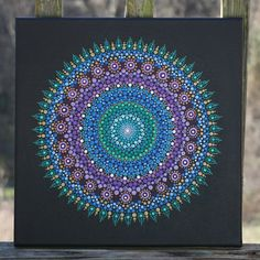 Light up your space with this gorgeous 12 x 12 dot mandala painting on wrapped canvas. Original artwork, painted and sealed by me.  Piece will