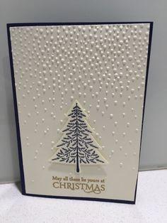 """Stampin' Up! Elegant Christmas card using Softly falling embossing folder with """"Peaceful pines"""" and """"Versatile Christmas"""" stamp sets with coordinating Night of Navy card stock and ink, Vanilla card stock and gold embossing powder. by pam.lemke.56"""